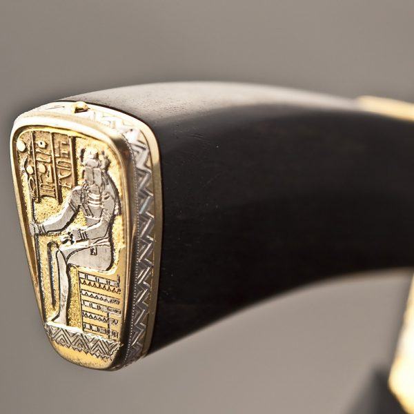 The back of the knife depicts Khepri himself with a scarab head and a royal rod in his hand.