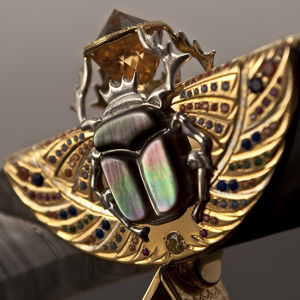 Depicted in the form of the sacred scarab beetle, God Khepri symbolizes the invisible power of creation which gives impetus to the movement of our sun in the sky and all things.