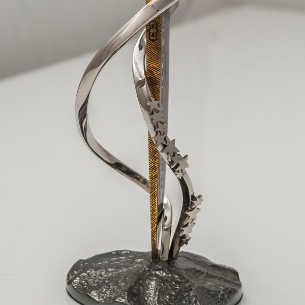 Blade of a knife on a stand decorated with a star. Author's work
