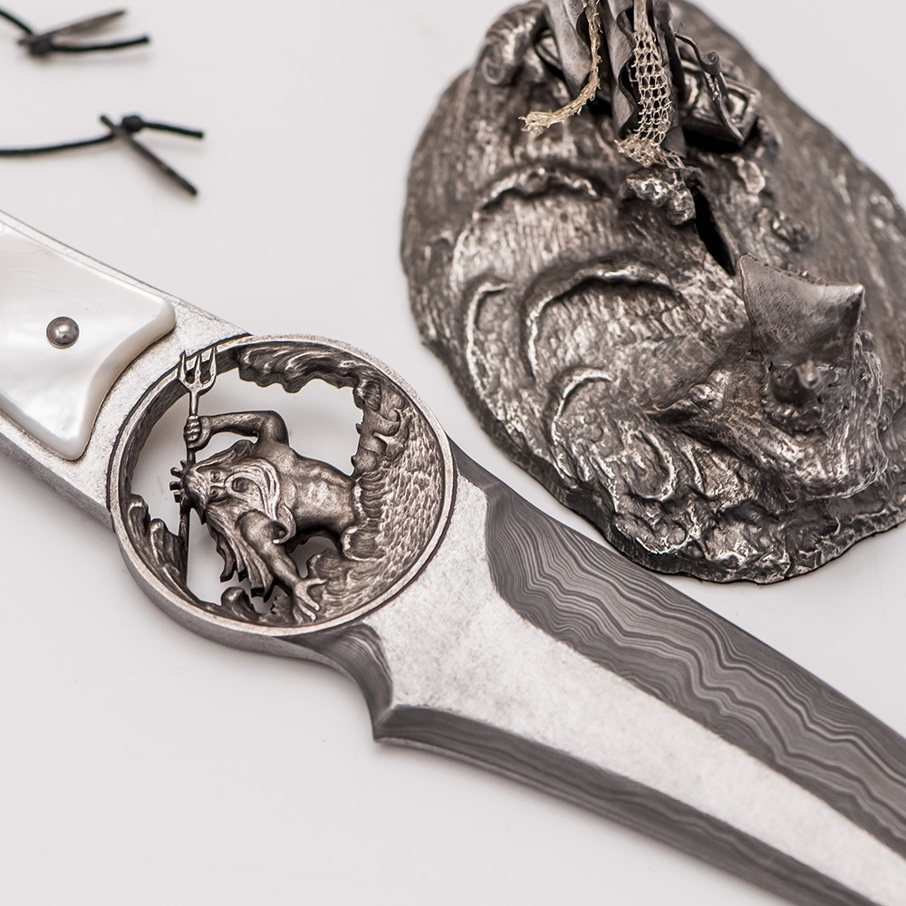 Poseidon with a trident - the main image of the author's handmade knife. Posted by: Olga Morozova