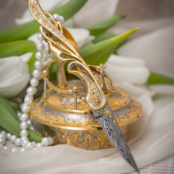 """Jewelry work of a female knife """"Shoe"""". Handmade, 24K gold plated and Damascus steel blade."""