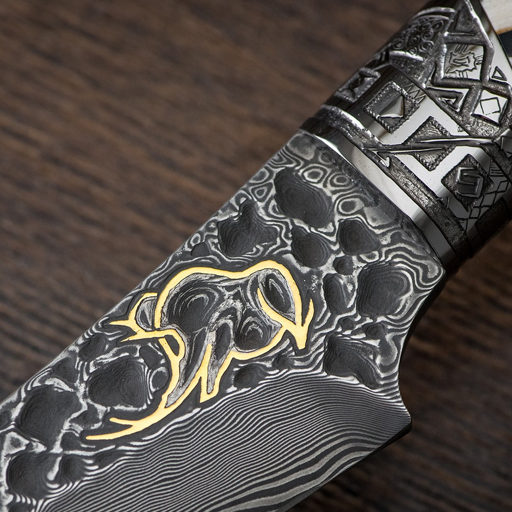 The blade is made of Damascus steel decorated with a Golden drawing of a mammoth. Author's work by Tatiana Sultanova