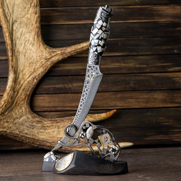 Knife composition with a stand of the figure of a mammoth. Handmade by Tatiana Sultanova. The handle of a knife made of mammoth tusks and ivory