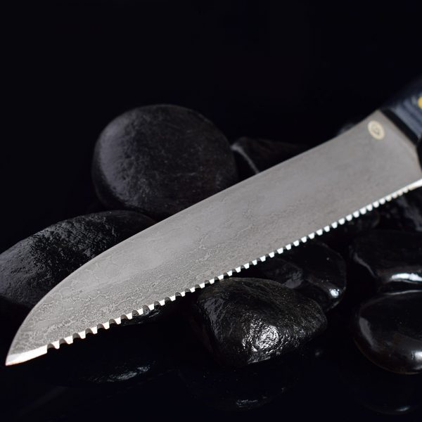 Handmade knife by Sergey Baranov. The blade of the knife is made of bulat steel, obtained by the secret technology of Sergey Baranov. Russian metallurgist who discovered the secret of the production of bulat steel.
