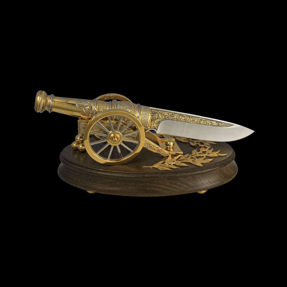 Golden gun composition. Handmade knife on a stand in the form of a gun. Decoration of the interior of the office.