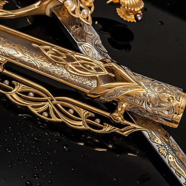 The golden sheath of the Qatari dagger is decorated with engraving and pearls