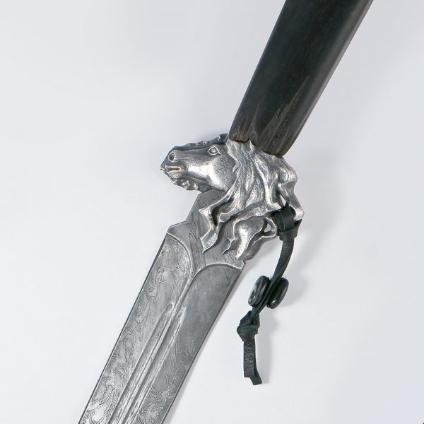 "The dagger's guard is made in the shape of a horse's head with a flowing mane and a pigtail ""woven"" into it with a guard amulet made of agate. The front part of the horse is covered with silver, it is clearly detailed, up to the expression of wise eyes."