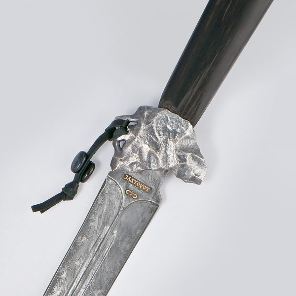 "The ""Quick"" dagger was born from a blade which was one of the first made by Vladimir Gerasimov in 2010, a metallurgical blacksmith who established the production of his own damask steel under the Zladinox trademark in Zlatoust. The blade has two fullers and a stiffening rib, the damask pattern is unusual in the fact that an attentive viewer sees the subtle winged horses in it."