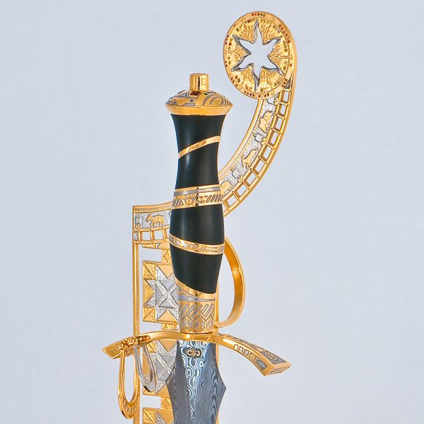 Author's composition by Tatyana Sultanova. Damask steel dagger on a gold stand decorated with precious stones