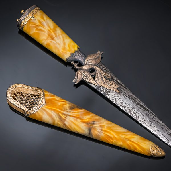 The blade in the scabbard locks the captive bird in a golden cage. It was with the theft of the Firebird in the golden cage that the magical journey of the fairy tale character began.