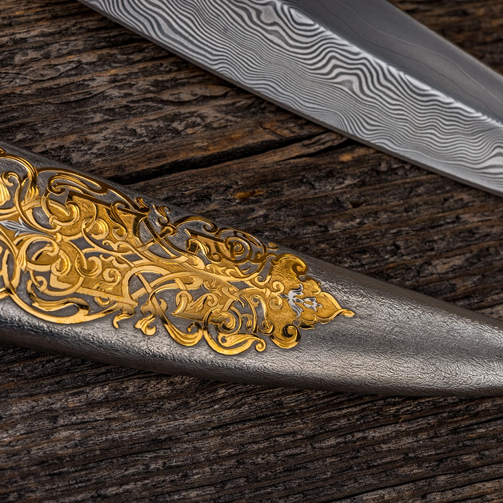 Metal sheath of jewelry work. Silver rhodium plating. On the surface, a floral ornament covered with gold is manually carved.