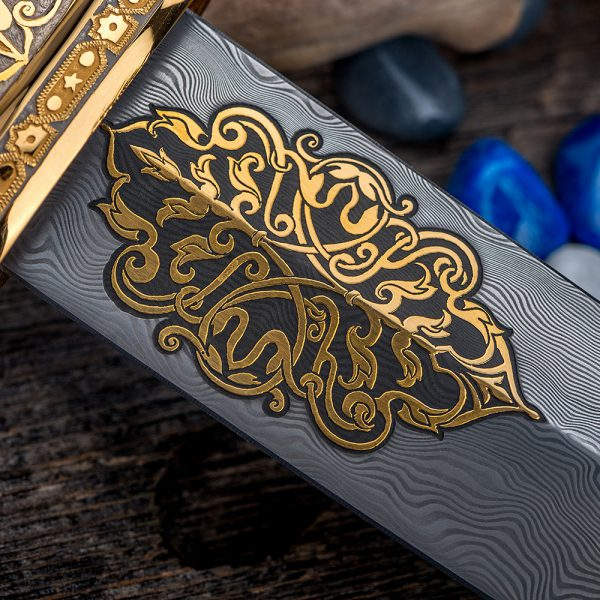 Damascus blade decorated with gold ornaments.