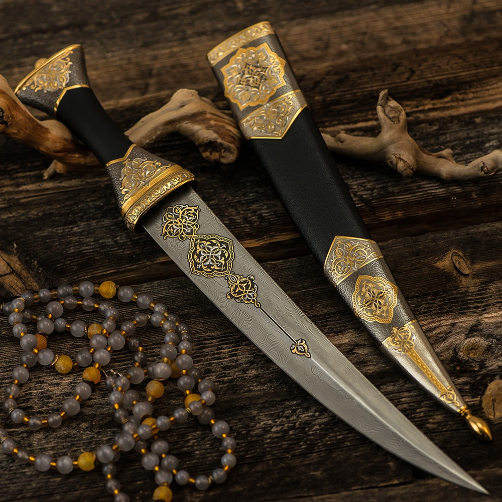 Luxurious arabic dagger made of noble materials. The dagger blade is forged from art damask with gold script. Exclusive gift for men.