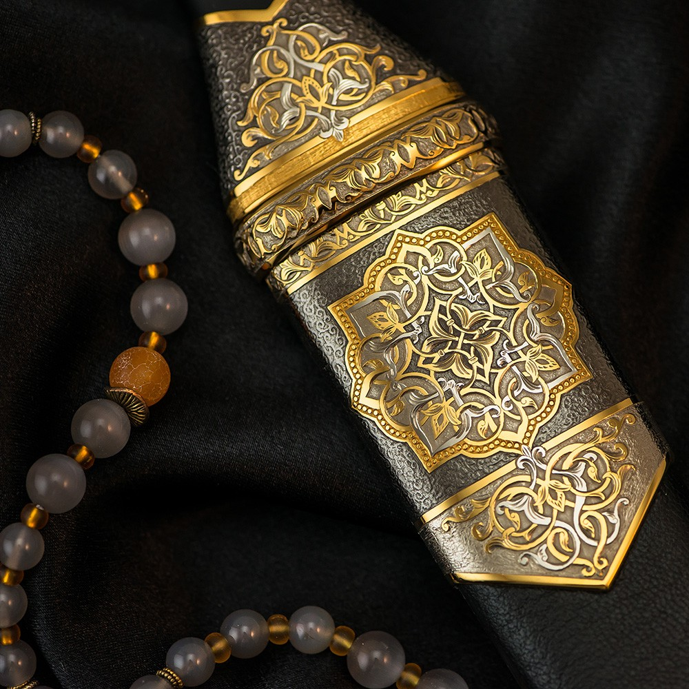Amazing oriental ornament on the surface of the dagger