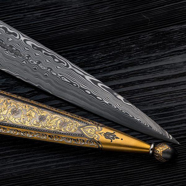 Art Damascus blade on black wood.