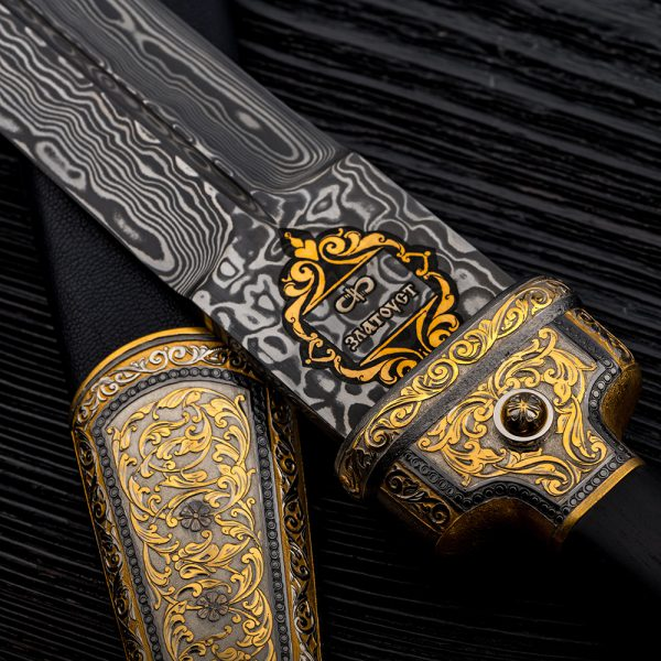 "The inscription ""Zlatoust"" in Russian on a blade of Damascus steel. Jewelery Weapon"
