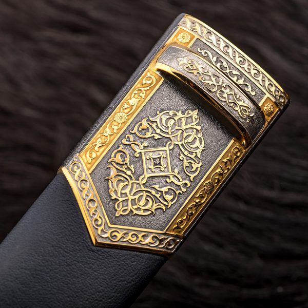 Dagger sheath with jewelry engraving. The surface is coated with rhodium-plated metal of the platinum group