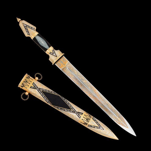Dagger with inserts made of stingray leather on a sheath and hilt. The dagger's canvas is abundantly covered with a pure gold handmade pattern.