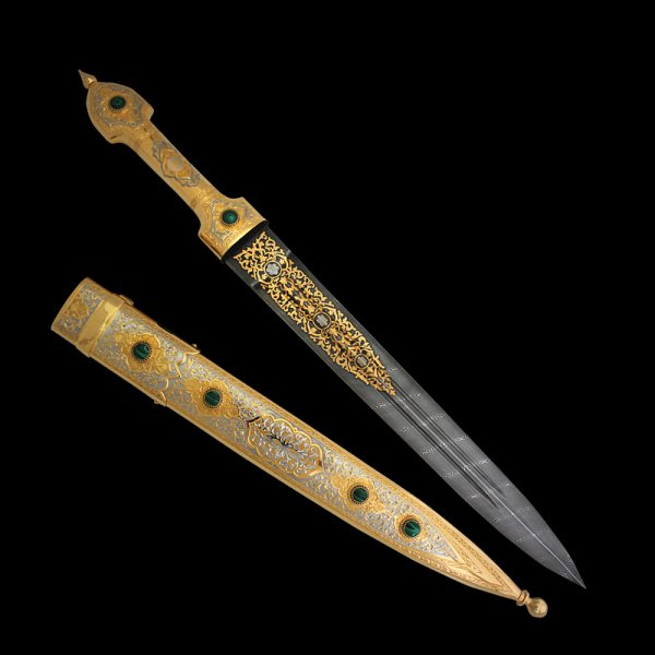 The dagger blade is made of strong damask steel. To decorate metal elements of the hilt and scabbard, as well as blade surfaces, the techniques of Zlatoust engraving on metal were used. These include brush painting, needle engraving on varnish, etching, engraving with a cutter, polishing, and inserts of precious malachite. Nickel plating and gilding emphasize the beauty of the design and details.