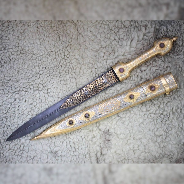 Dagger decorated with embossed engraving decoration with rhodonite stone cabochons.