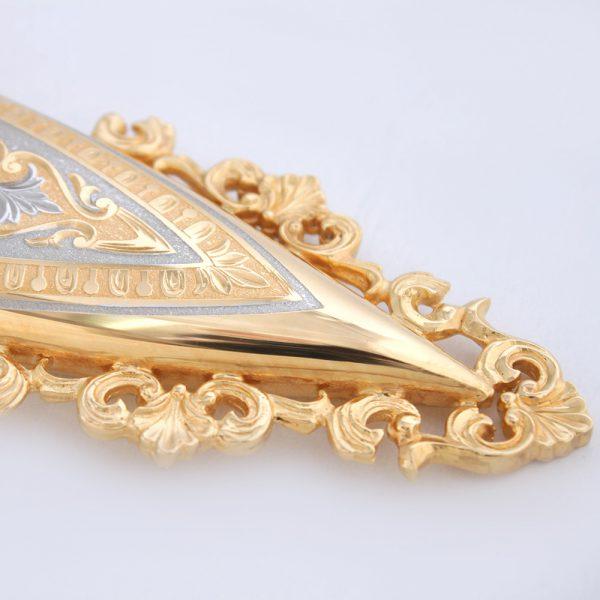 Golden scabbard tip decorative cast curls. Baroque scabbard