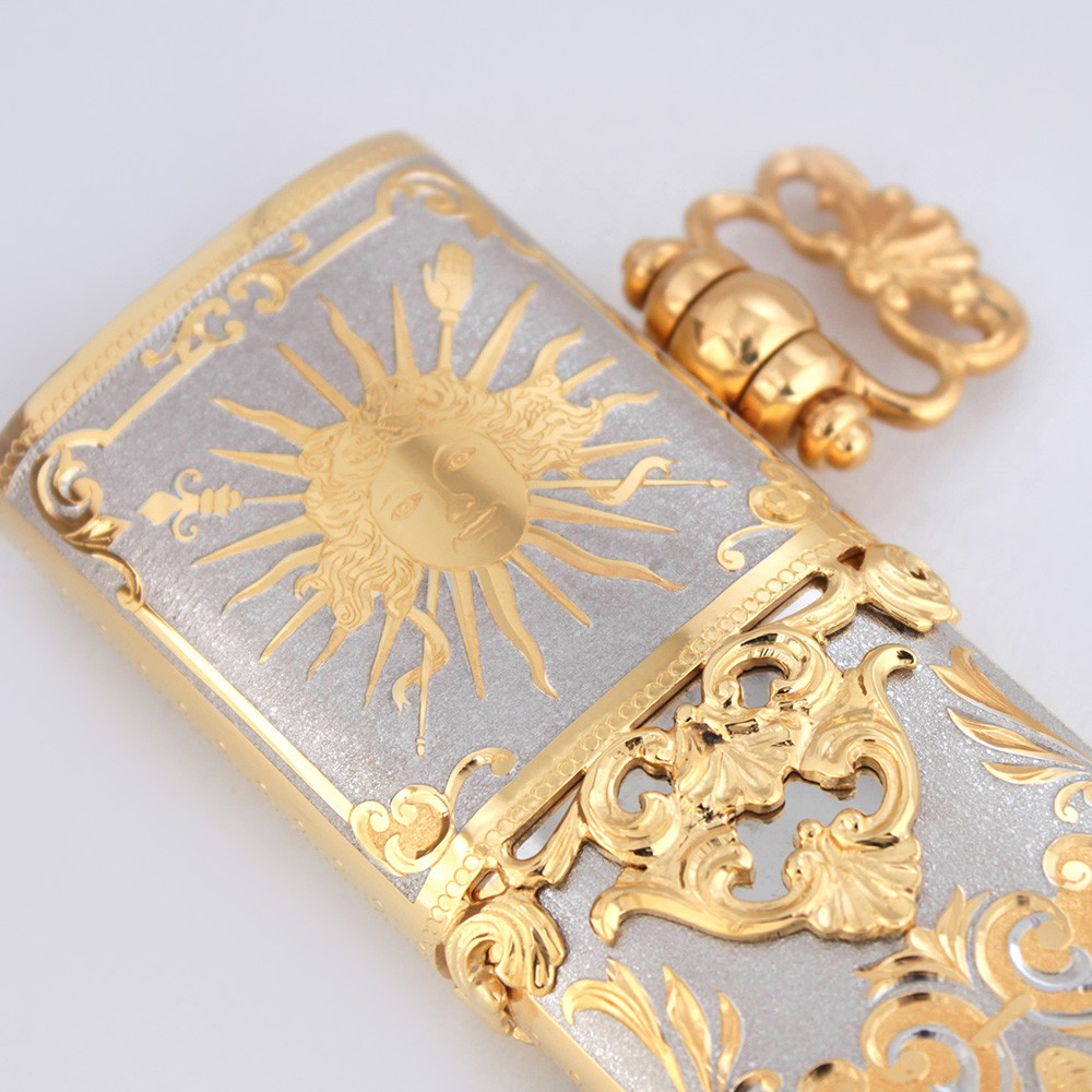 Golden sun on a metal sheath of a dagger