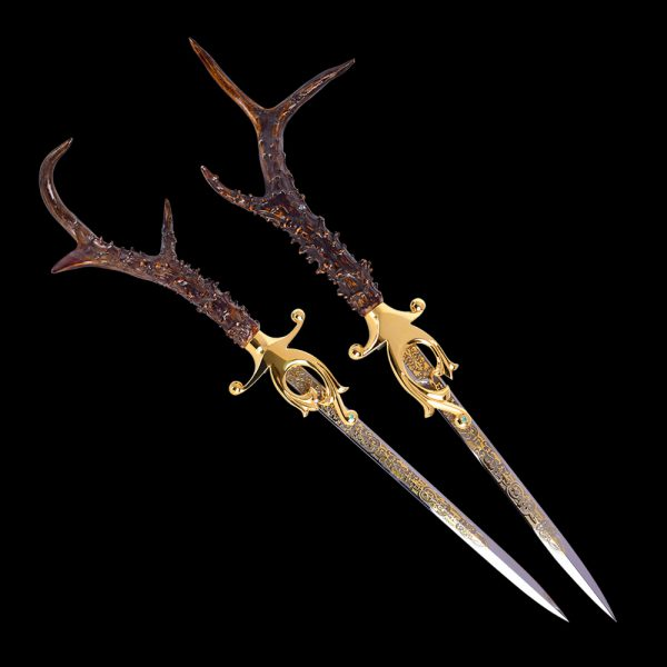 A pair of luxurious daggers with deer horn handles.