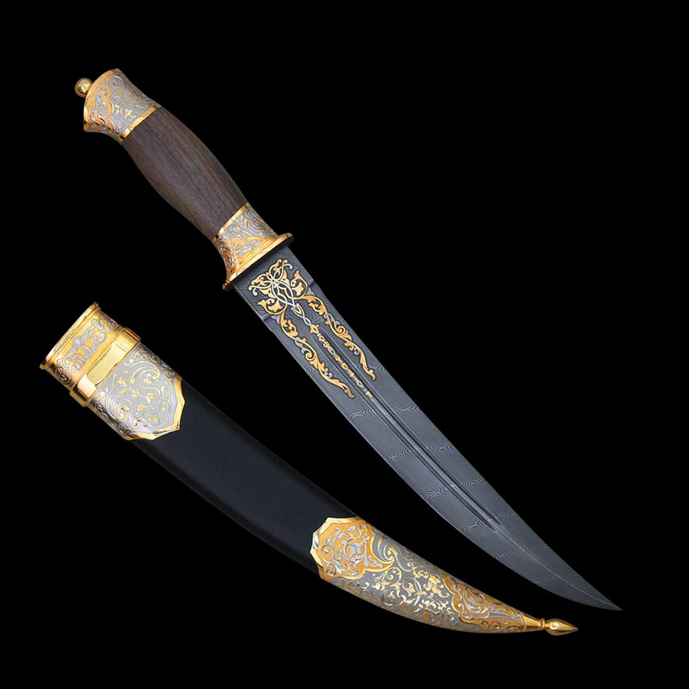 Bebut with a damask blade is covered with gold ornament. On a cloth two longitudinal dolas are located.
