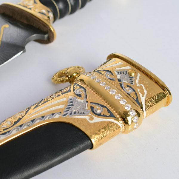 Sheath decorated with embossed engraving and transparent crystals.