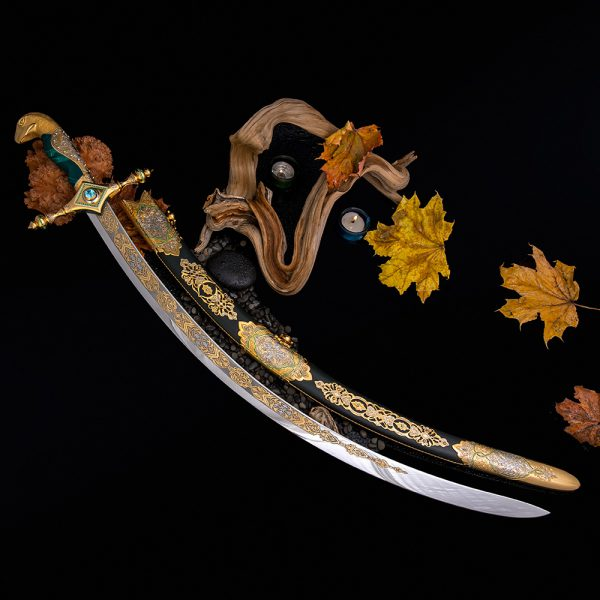 Arabic sword jewelry work. Saber Golden Falcon