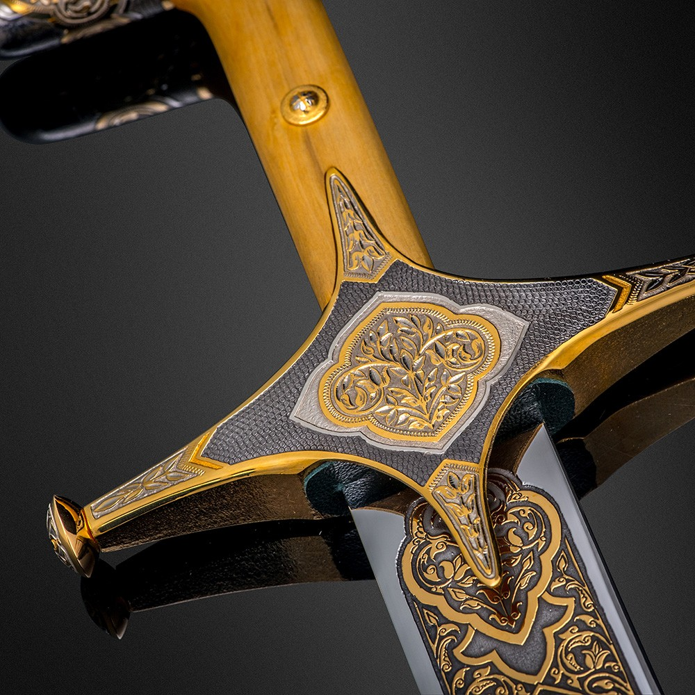A decorated hilt of an Arabian sword with an ornate crosshair. The surface is manually engraved by the master under the microscope.
