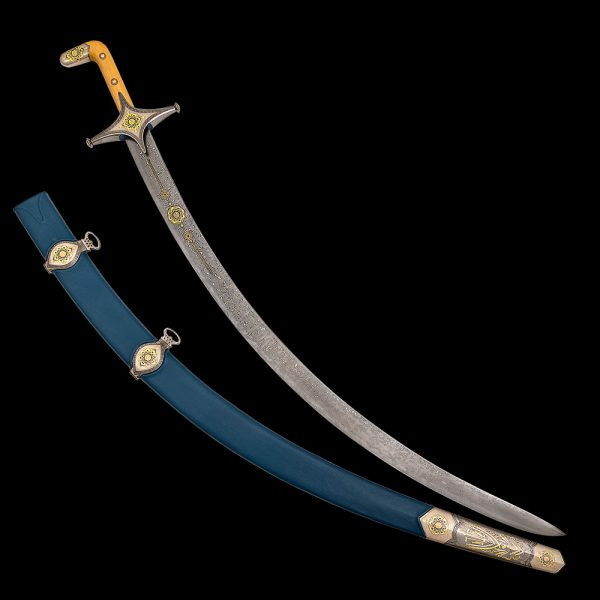 The saber blade is narrow, but thick enough, strongly curved. This blade curvature has historical roots and recalls the combat version of this weapon, capable of delivering very effective blows when cutting. Dark steel has a clearly visible characteristic damask pattern.