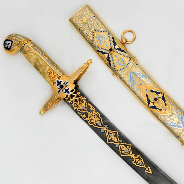 Arabic sword with a wooden hilt and a damascus blade with 24K gold plating and ornamental enamel