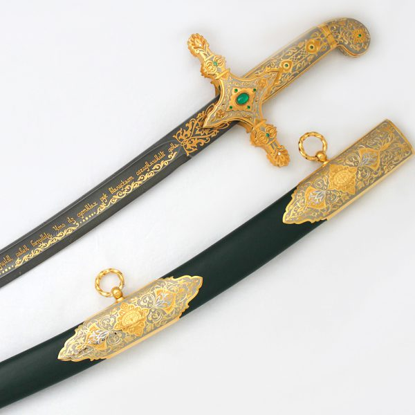 Green scabbard of arabic sword decorated with gold inlay with jewelry stones.