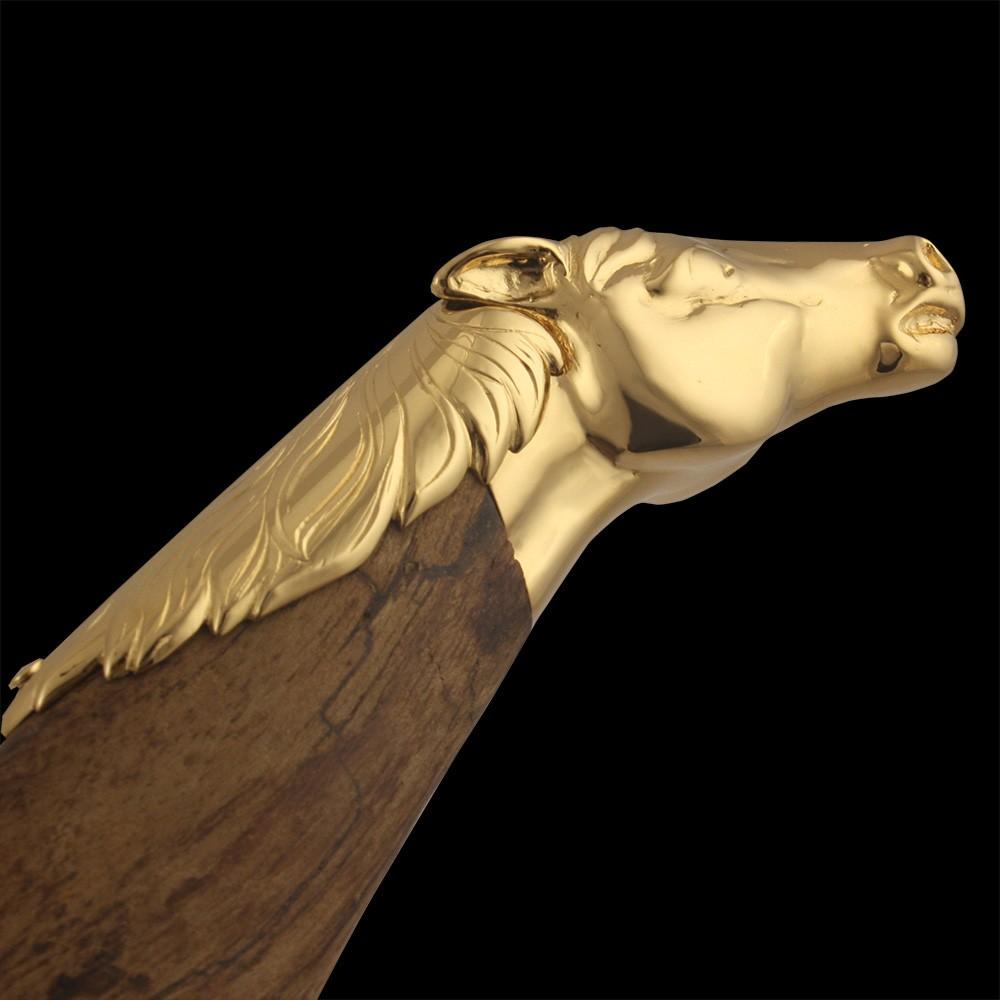 Wooden hilt of arab sword with golden horse head