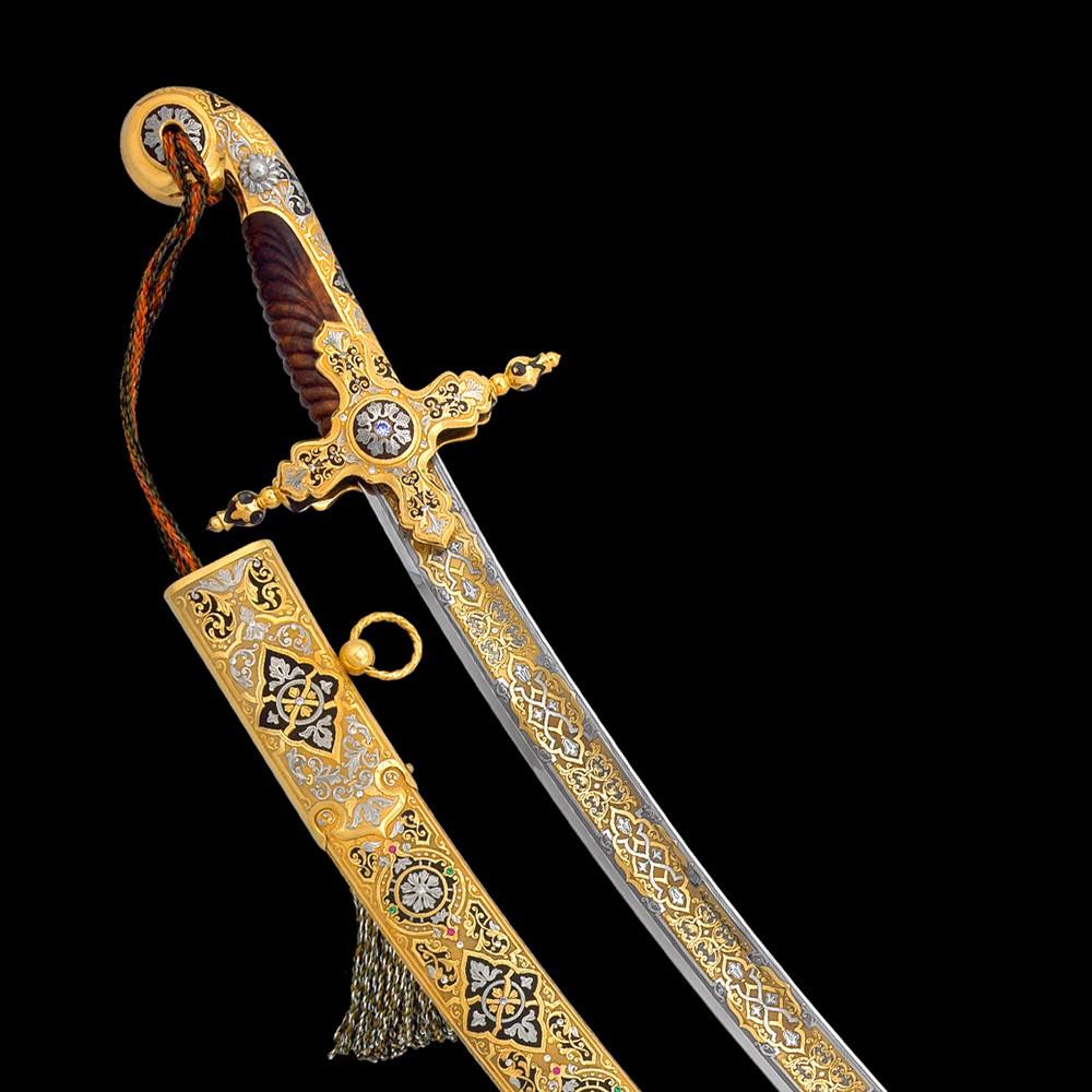Oriental saber richly decorated with hand engraving, gold and crystals.
