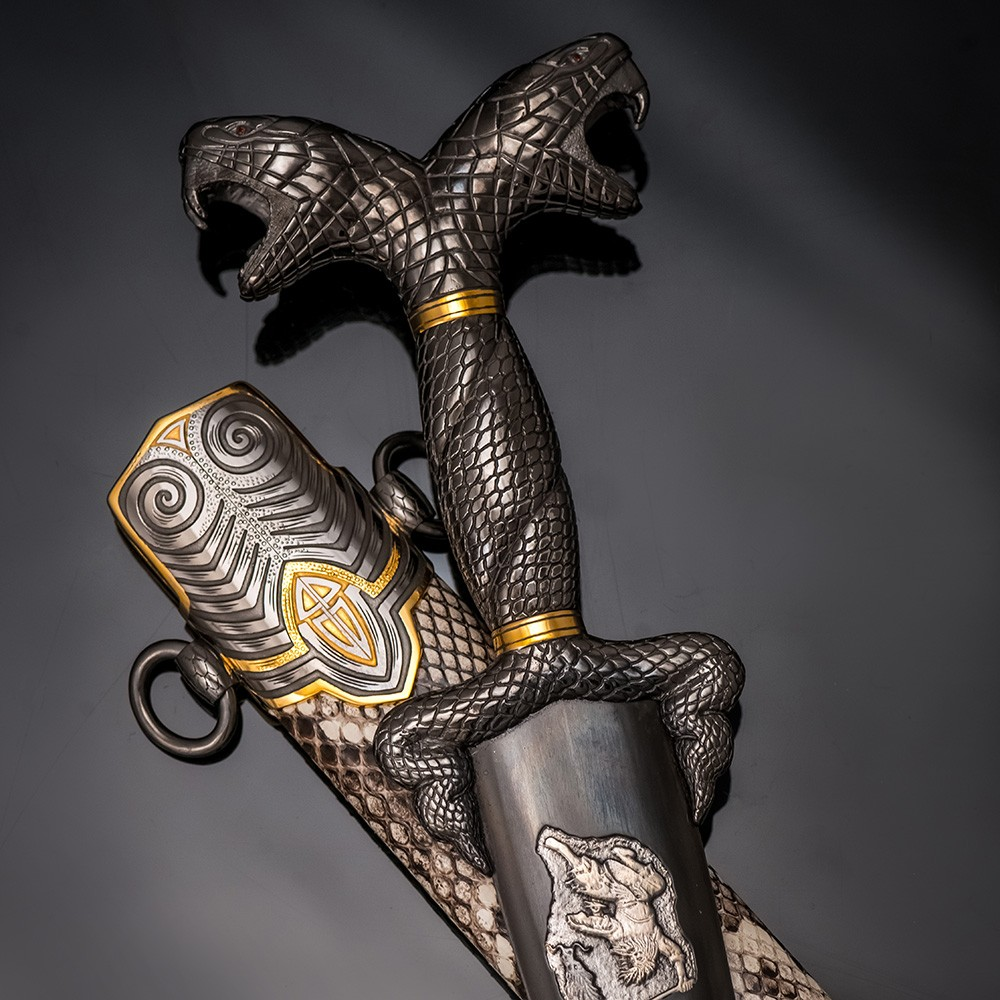 "The ""Susanoo"" sword symbolizes the eternal struggle of light and darkness and conveys the spirit of victory and the strength of faith of the hero, who dared to engage in battle with a terrible enemy. The authors managed to combine the threads of the past and the present, find the points of intercourse of cultural traditions, fuse the achievements of the Ural masters and Japanese gunsmiths into a single whole and offer their own, original version of the mythical sword."