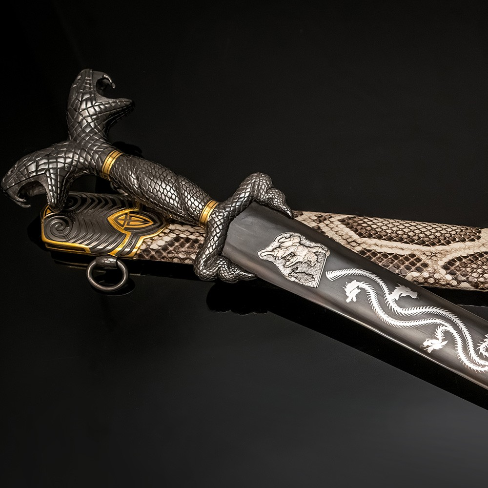 Luxurious Japanese sword with a blade decorated with a silver dragon.