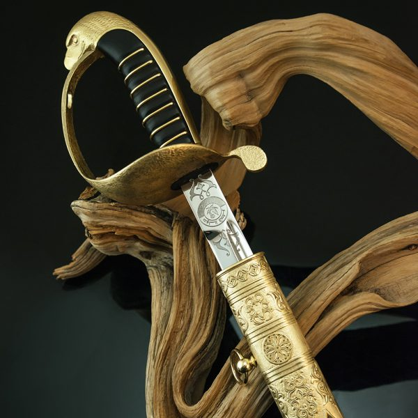Handmade souvenir sword. The handle has a hilt and the head of an eagle.