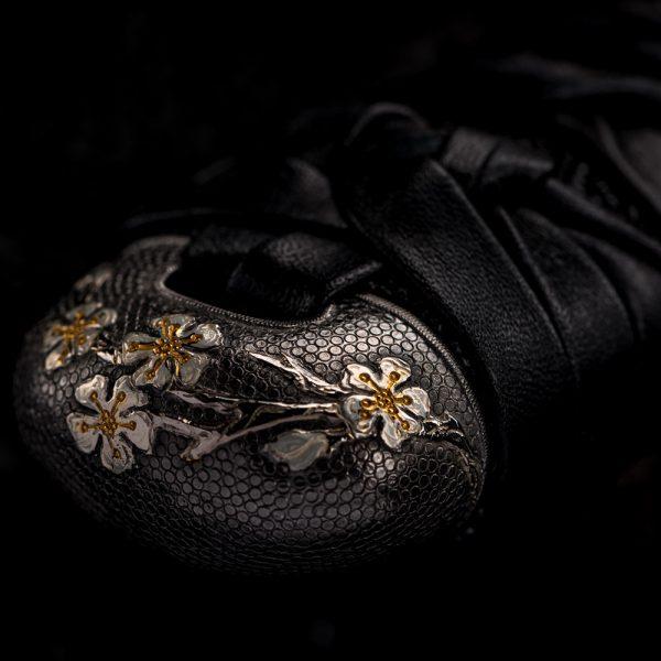 Katana hilt stylized as snake skin coated with precious metal - rhodium
