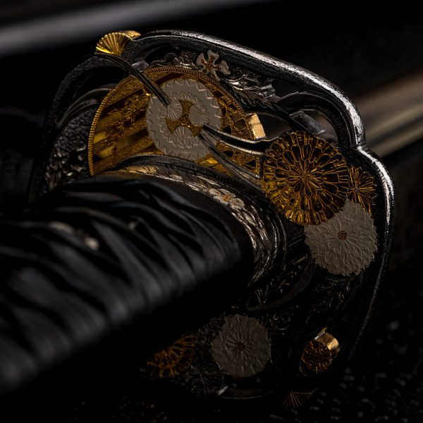 Stylish katana hilt adorned with traditional Japanese designs