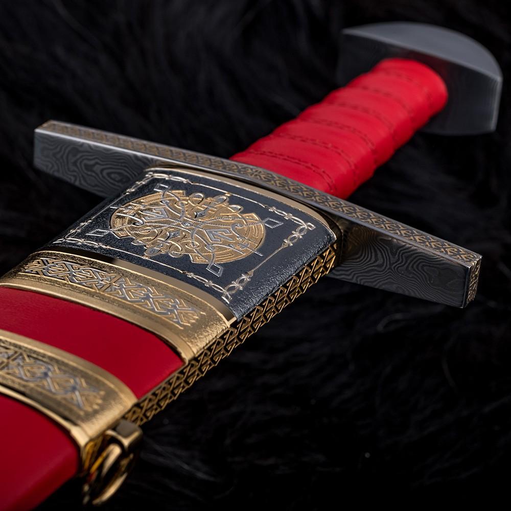Handmade stylish crosshair of a decorated sword
