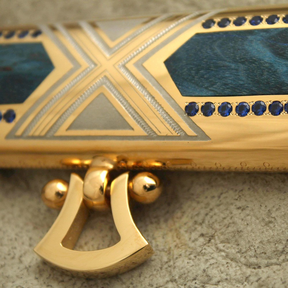 Scabbard decorated with inlaid blue stones and inserts of wood