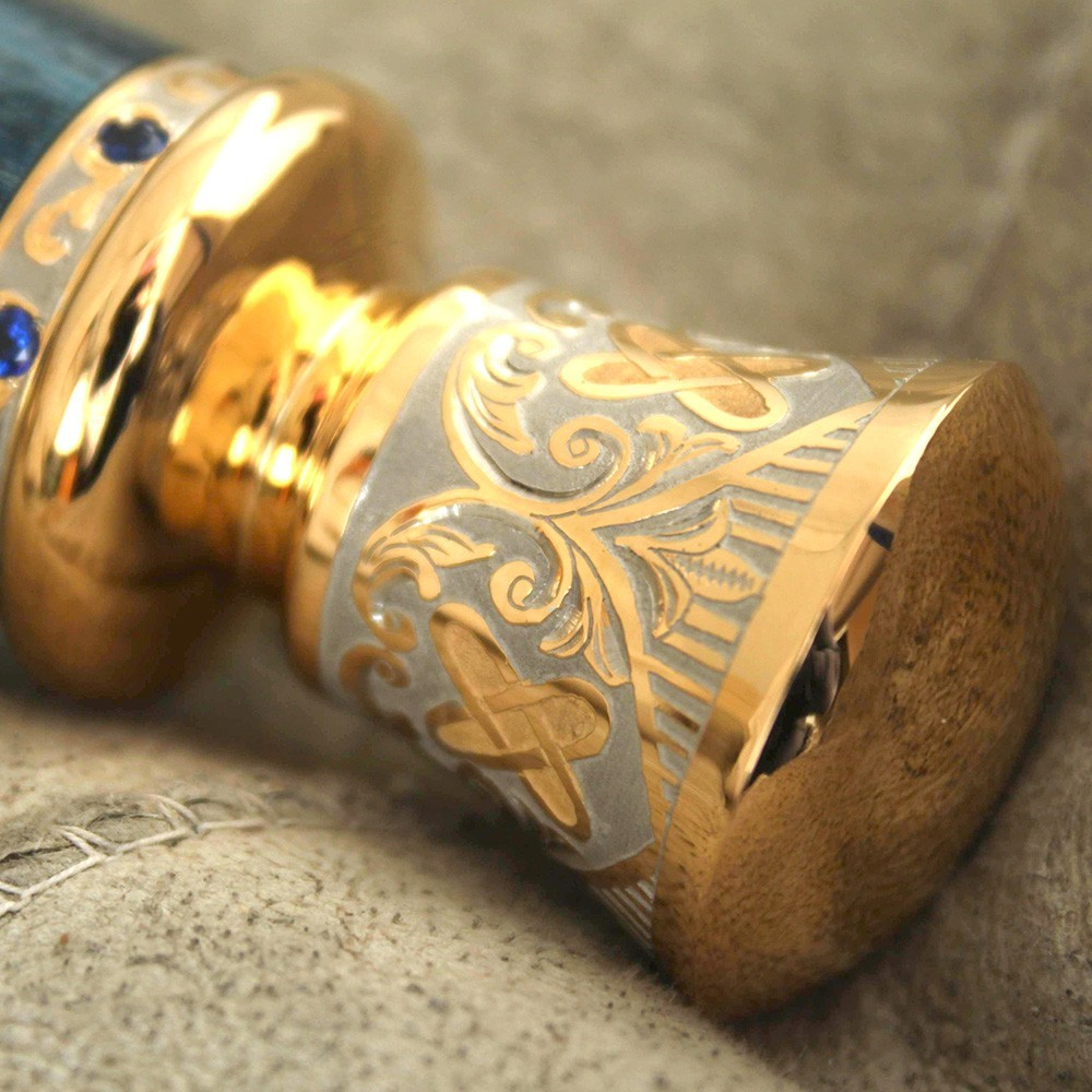 The pommel of the handle is hand carved and engraved