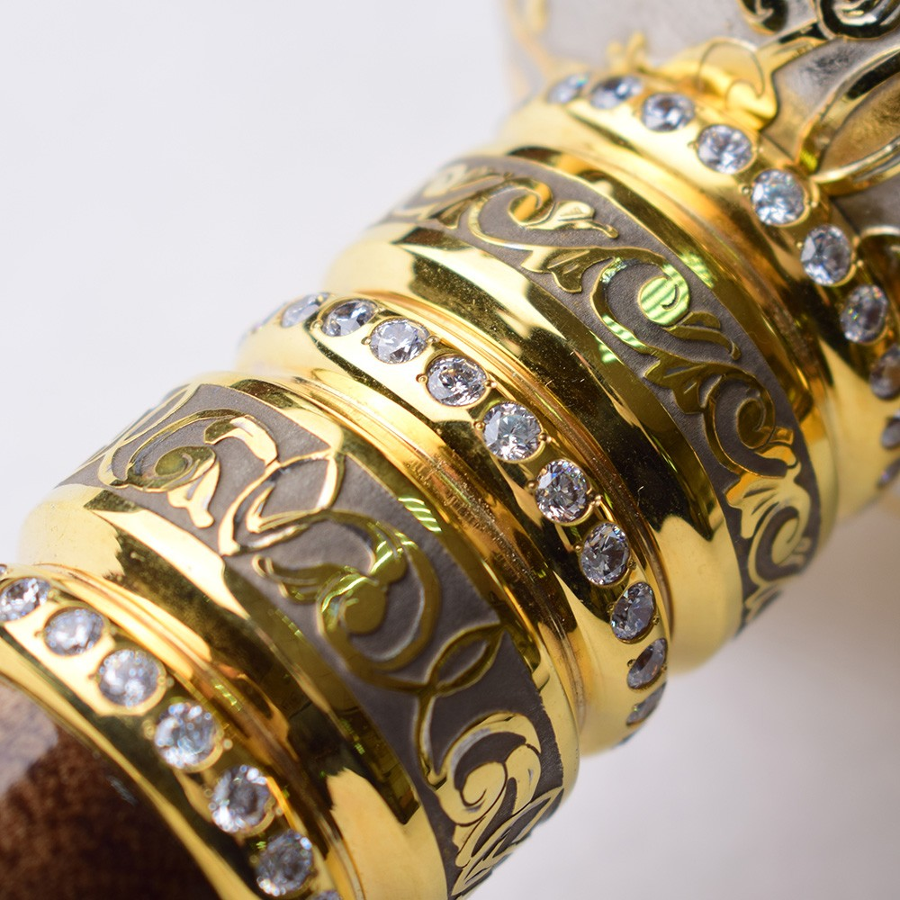 Gold rings with stones on the hilt of the mace