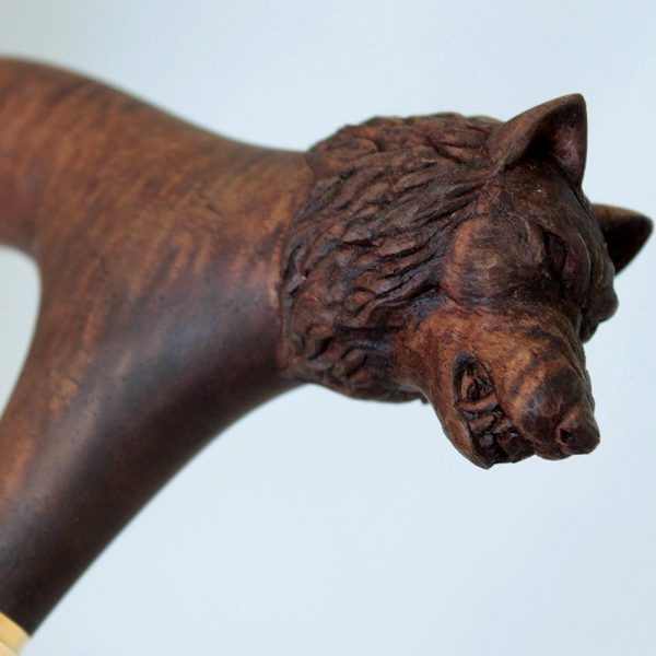 Wooden hilt with a carved wolf head.