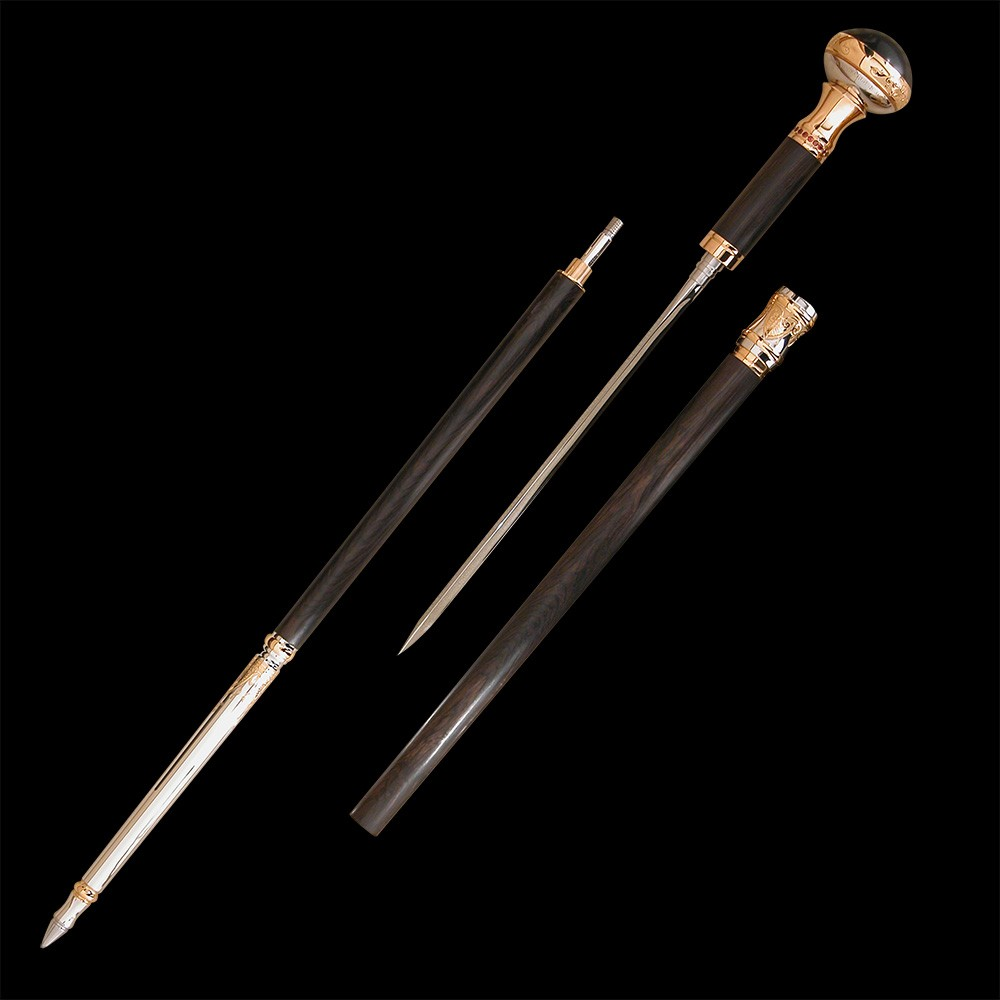 Handmade designer cane is disassembled into three separate elements. Stick with stylet, wooden trunk, tip