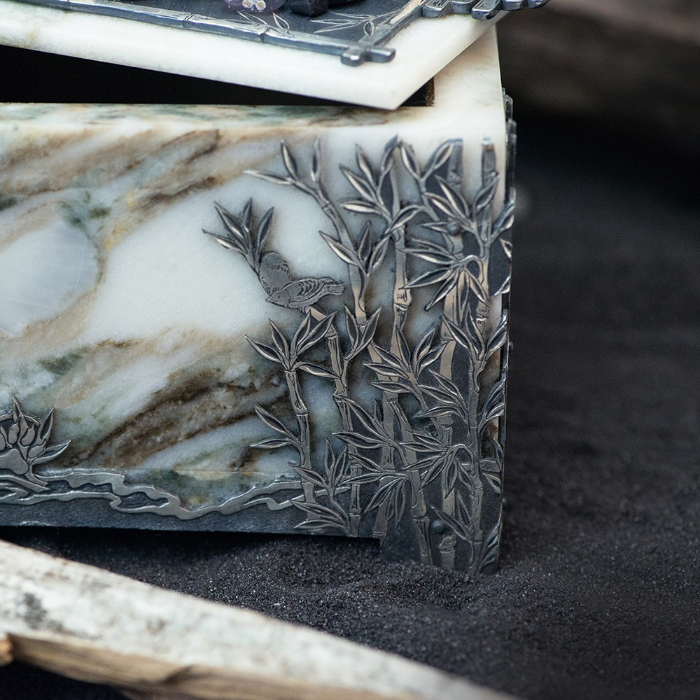 "The casket is partially silver-plated, processed with a special method of patination – the effect of ""aging"" of the noble metal gives the item an elegant look."