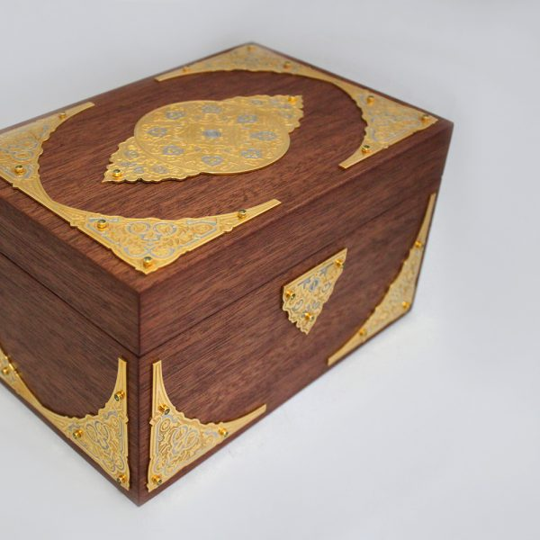 The box is decorated with metal plates with engraved patterns.