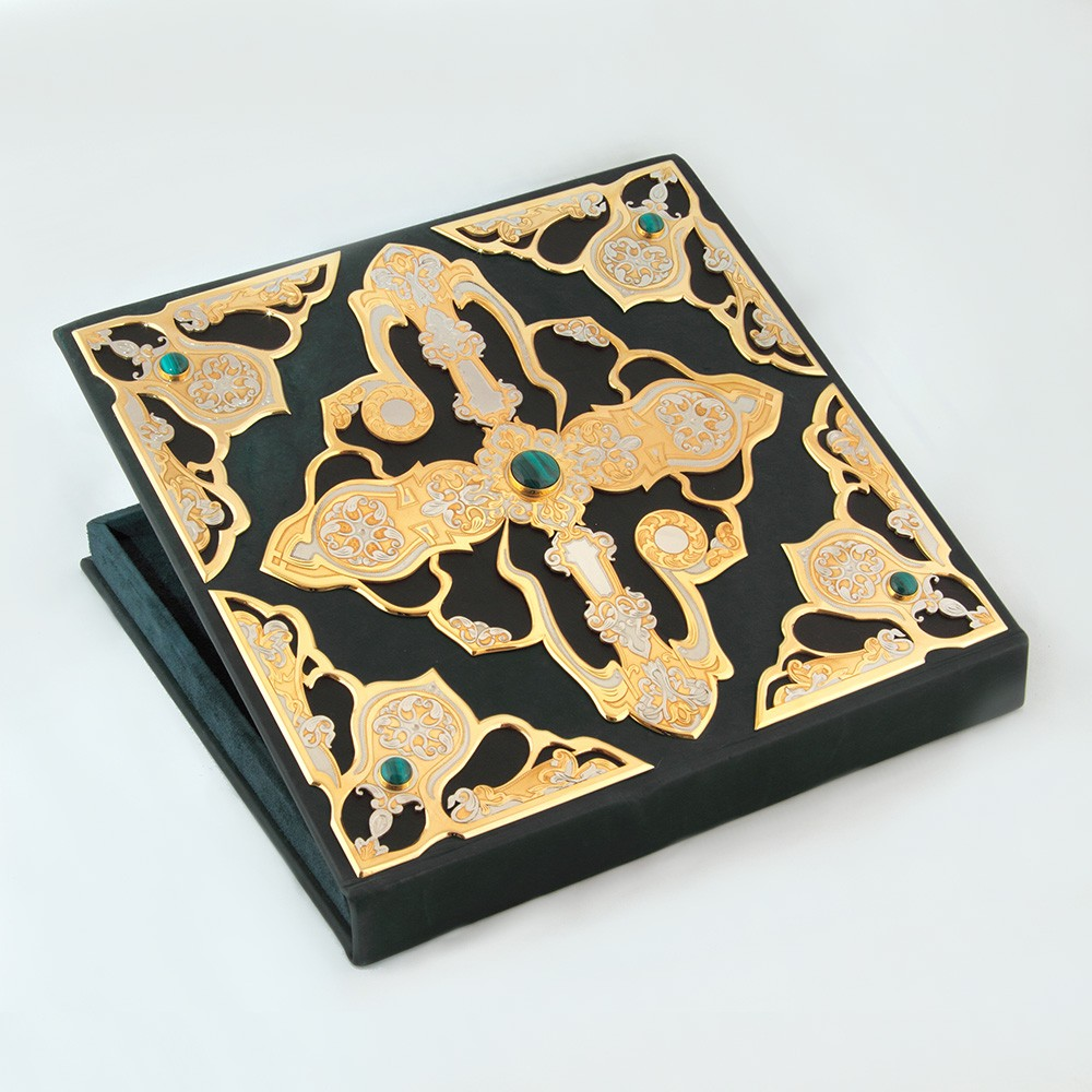 Handwork. Leather and velvet box with gold carvings for storing a luxurious necklace
